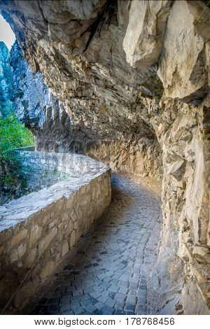 Tourist attraction, Matka Canyon in the Skopje surroundings, Macedonia. Hiking trail along side the mountain.