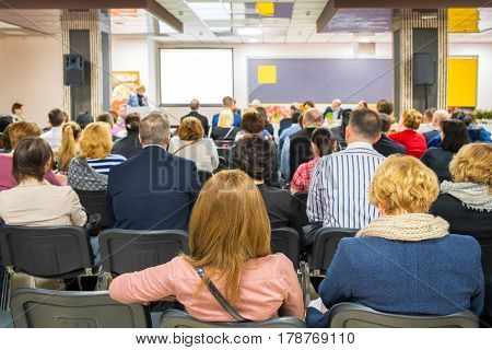 Indoor business conference presentation for group managers