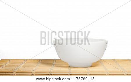 White Crockery On A Bamboo Mat