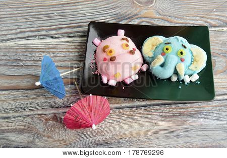 The hippopotamus and elephant are made of ice cream and coffee. A creative dessert for children and good mood.