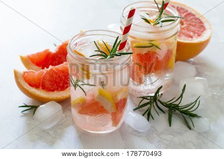 Refreshing Summer Drink With Grapefruit And Rosemary On A Stone Background. The Concept Of Eating Ve