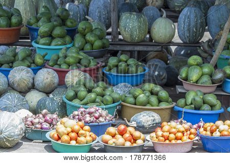 Fresh fruits and vegetables on display at roadside produce stand in Uganda Africa.