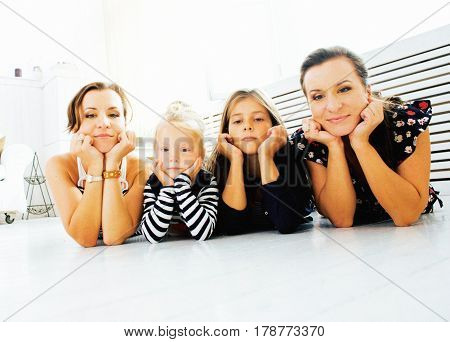 Mature sisters twins at home with little daughter, happy family smiling close up, lifestyle modern real people concept cheerful