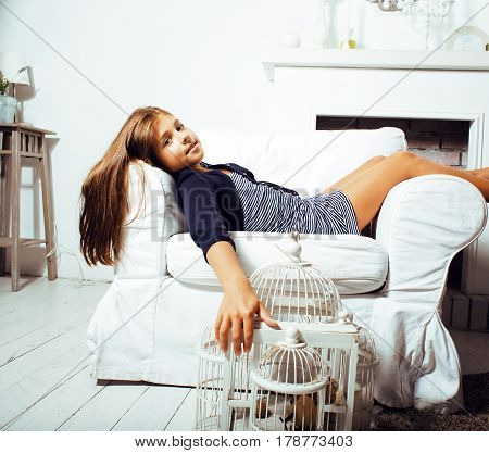 little cute brunette girl at home interior happy smiling close up, lifestyle real people concept with toys