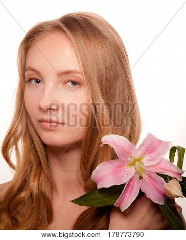 Beautiful young woman with lily isolated on white background