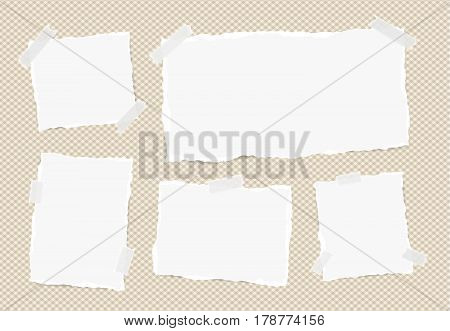 Different size white note, notebook, copybook sheets, strips stuck with sticky tape on squared brown background.