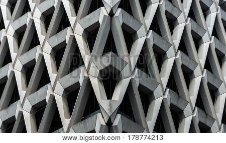 Detail of brutalist concrete diamond shaped facade of the car park in Welbeck Street London.