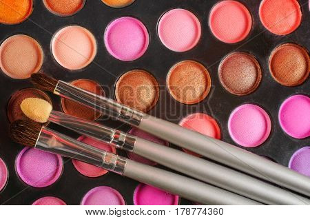 Brushes On The Palette Of Eye Shadows