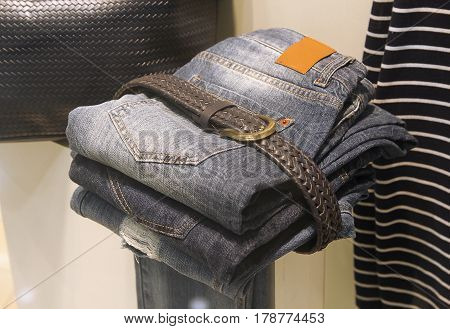 Jeans are in the shop window. Sales