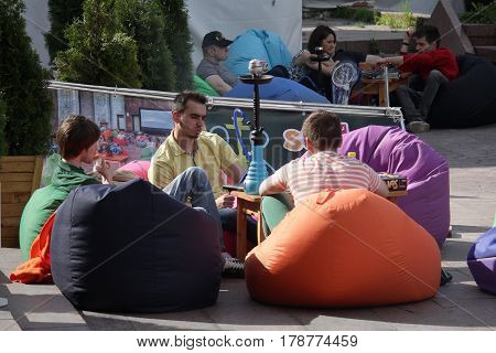 Kiev Ukraine - May 27 2016: Men are relaxing with a hookah on a day off in the city center