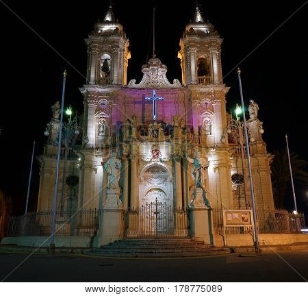 Zabbar Parish Church in the night lights. View of the Zabbar Parish Church in the evening. Preparing for Easter. Madonna tal-Grazzja. Malta