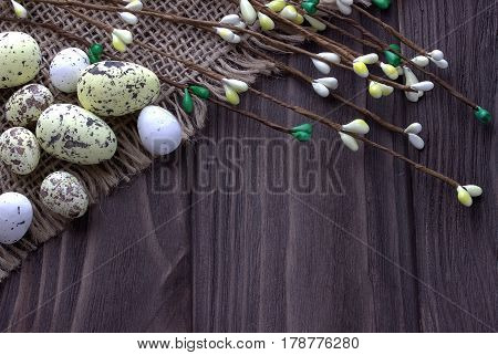 Easter Eggs On Burlap Cloth With Branches.