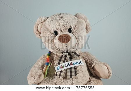 A cute teddy bear with a pacifier and the headline