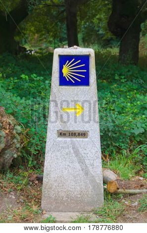 Camino de santiago way marker. Road sign made in stone. Milestone used for pilgrims to walk in the correct direction