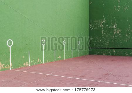 Typical fronton court painted in green. Fronton is a building where pelota or jai alai is played