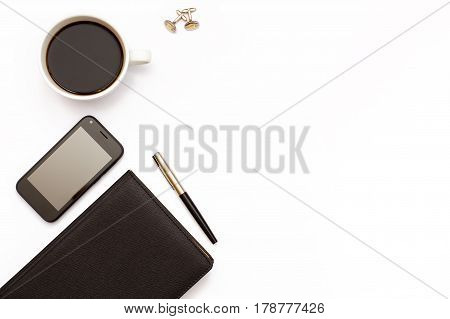 Black, Diary, Pen, Cufflinks, Cup Of Black Coffee And Phone On White Background. Desk In The Office.