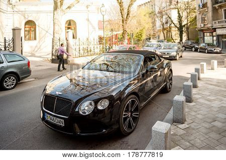 BUCHAREST ROMANIA - APR 1 2016: Luxury Bentley Continental GT Convertible Cabriolet parked on the street of the Eastern Capital city of Bucharest Romania