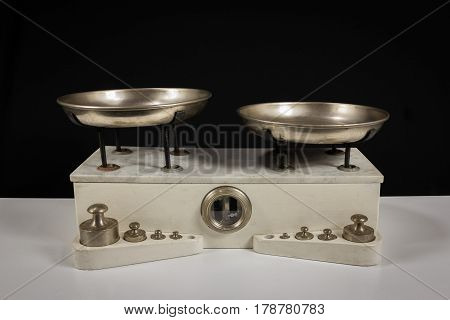 Balance with two metal plates with weights
