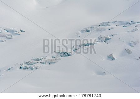 Glacier crevasses and seracs in a snow field in the high alpine Vallee Blanche in winter
