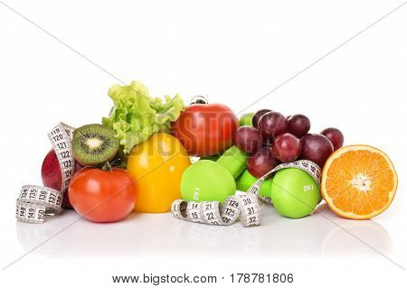 fitness equipment and healthy food isolated on white. green apple, pepper, grapes, nectarines, kiwi, orange, dumbbells and measuring tape