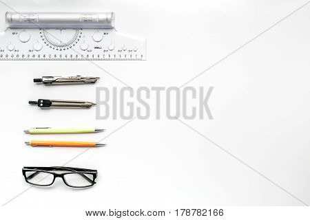 profession concept with architect desk and constructor tools and glasses on white background top view mock-up