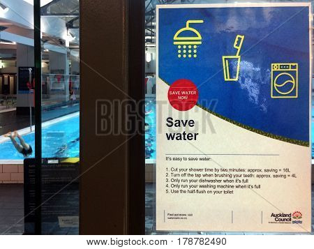 AUCKLAND - MAR 20 2017: Save water sign.The city's water company ask people to reduce their daily water usage by 20 litres a day as Further rains forecast for Auckland could exacerbate water shortages
