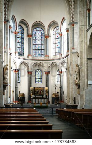 COLOGNE, GERMANY - NOVEMBER 24: The interior of the St. Kunibert church with the altar religious relics and a triptych on November 24 2016 in Cologne.