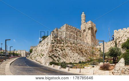 Tower of David and Jerusalem Citadel under blue sky (panorama).
