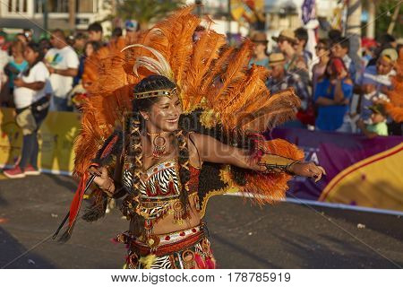 ARICA, CHILE - FEBRUARY 10, 2017:Tobas dancers in ornate costume performing at the annual Carnaval Andino con la Fuerza del Sol in Arica, Chile
