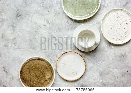 ceramic tableware top view on stone background mock up.