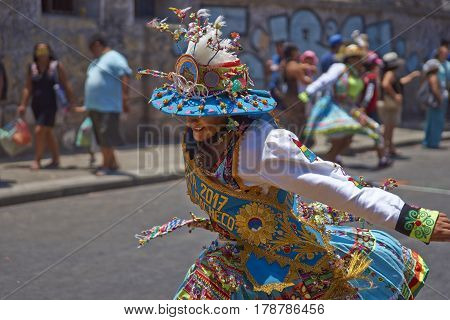 ARICA, CHILE - FEBRUARY 11, 2017: Tinkus Dance Group dressed in ornate costumes performing a Tinkus dance during a street parade at the annual Carnaval Andino con la Fuerza del Sol.