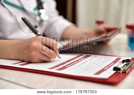 Doctor Writes In Patients Medical History