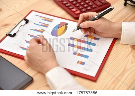 Woman Working With Business Graph