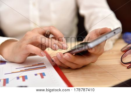 Hand Of Businesswoman Touching Phone