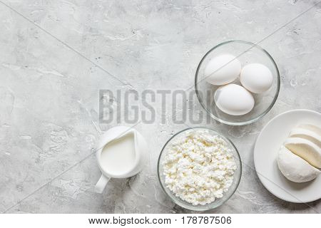 monochrome concept with dairy products for proteic breakfast on stone table background top view mock up