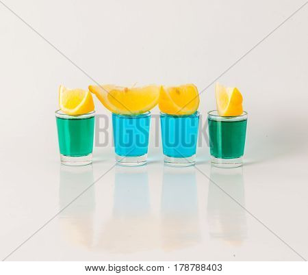 Glasses With Blue And Green Kamikaze, Glamorous Drink, Mixed Drink Poured Into Shot Glasses