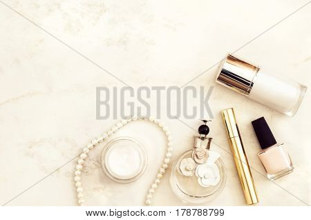 Beauty products top view on white marble background. Flat lay for fashion blogger. Copy space
