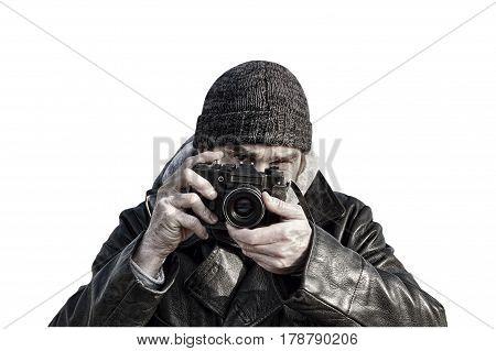 Photographer with retro photo camera isolated on white background.Toned image.