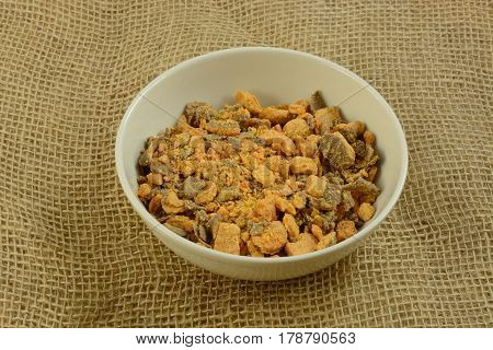 Bowl of crushed candy bar bits in bowl for cooking topping