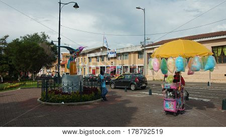Tumbaco, Pichincha / Ecuador - March 25 2016: Peddler selling cotton candy in the central park of the town of Tumbaco near the city of Quito