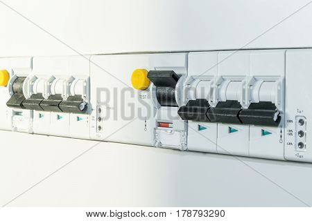A number of automatic switches and differential circuit breakers with led indication of the module implementation. Covered with protective panels in the electrical Cabinet or panel. Modern technology.