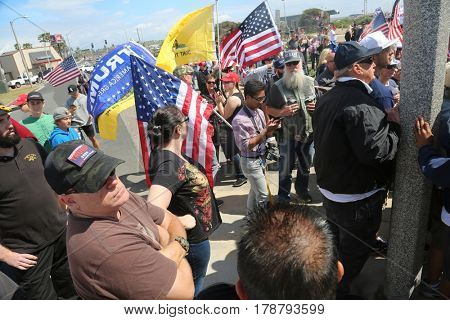 Huntington Beach, CA - March 25 2017: Make America Great Again March. Supporters and protesters of republican presidential candidate Donald Trump, cheer and jeer at a MAGA March in Huntington Beach.