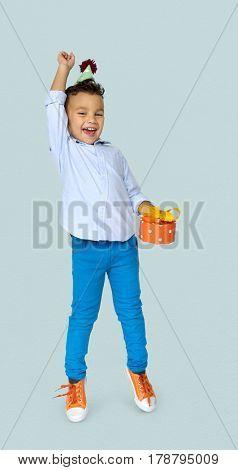 Little Boy with Gift Party Hat Studio Portrait