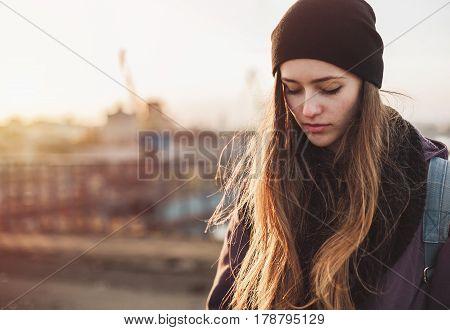 Portrait of a sad girl at sunset