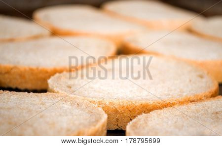 Preparing bread slices for sandwiches and greasing and frying