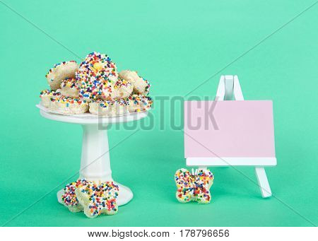 A new twist on Fairy Bread cut into flower and butterfly shapes and served on a petite pedestal pink chalk board blank for your message. Served at children's parties in Australia and New Zealand.