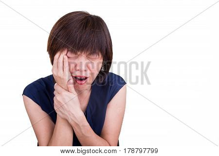 Asian Woman In Intense Pain With Hands Over Face