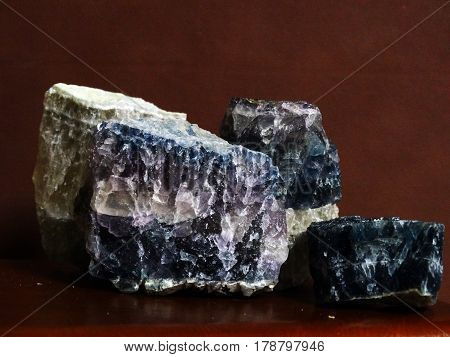 Crystals of polychrome fluorite macro shot dark