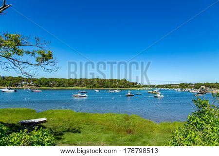 Pleaasure boats lay at anchor in Ryder's Cove off of Pleasant Bay near Chatham on Cape Cod in Massachusetts.