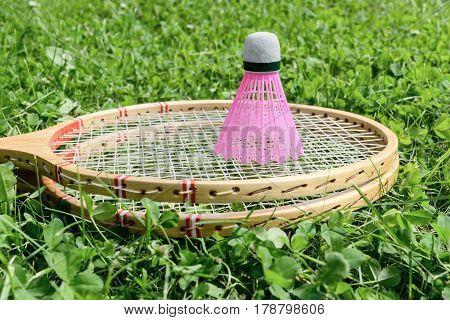 Badminton Rackets And Shuttlecock On Grass